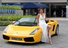 Model with Yellow Ferrari  at Singapore Flyer