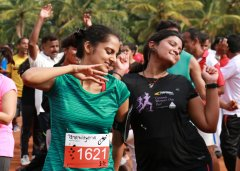 Two female runners dancing after a marathon