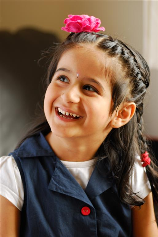 candid photograph of a smiling girl