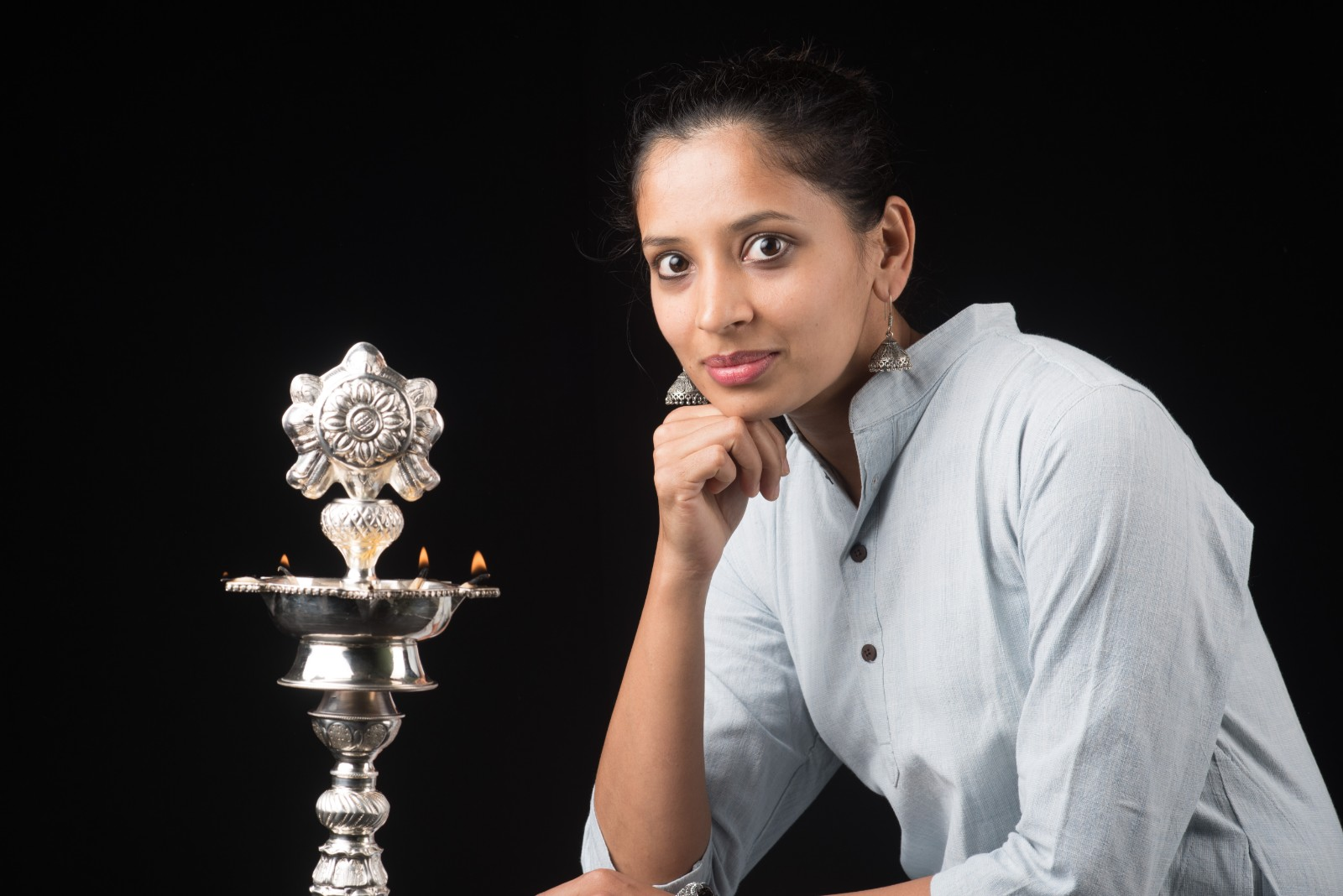 Indian Woman in front of a lamp