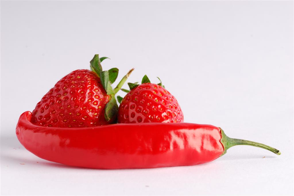 Photograph of red chilli and strawberries