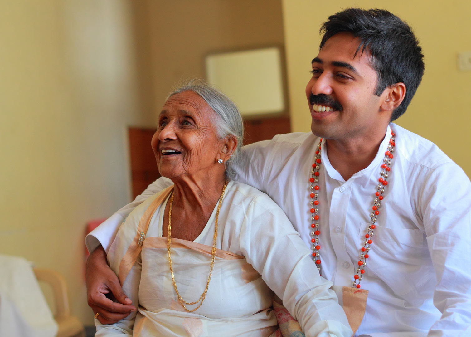 A happy granny with her grandson who is also the groom